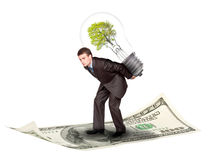 Businessman with eco lamp Stock Photography