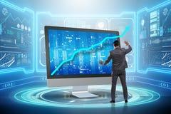 The businessman in economic forecasting concept with charts. Businessman in economic forecasting concept with charts Stock Photos