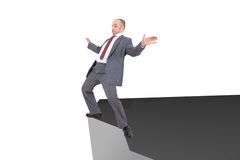 Businessman on the edge Stock Photography