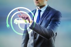 The businessman in electic vehicle concept stock photography