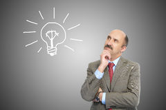 Businessman and electric lamp Royalty Free Stock Image
