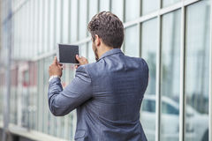 Businessman with an electronic tablet in the urban district Royalty Free Stock Photo