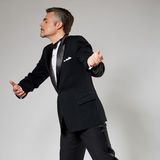 Businessman in elegant suit dancing with an Royalty Free Stock Image