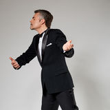 Businessman in elegant suit dancing with an Stock Photos