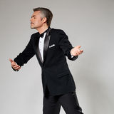 Businessman in elegant suit dancing with an Royalty Free Stock Images