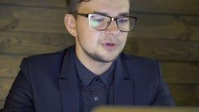 Businessman in elegant suit happily speaking in cafe stock video footage