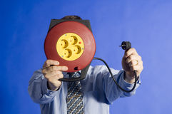 Businessman with eletric cord. Businessman holding a extension cable Stock Images