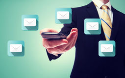 Businessman with email and cell phone Royalty Free Stock Photo