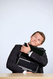 Businessman embracing laptop, looking up Royalty Free Stock Photography