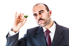 Businessman with emerald Royalty Free Stock Photography