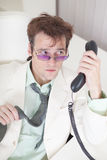 Businessman emotionally speaks on phone at office Stock Photography