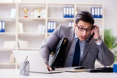 The businessman employee talking on the office phone. Businessman employee talking on the office phone Royalty Free Stock Image