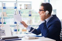 The businessman employee talking on the office phone. Businessman employee talking on the office phone Stock Photo