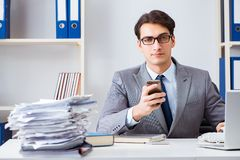 The businessman employee talking on the office phone. Businessman employee talking on the office phone Stock Photography