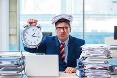 Businessman employee in urgency and deadline concept with alarm. Clock Stock Photography
