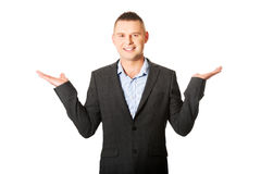 Businessman with empty both hands. Happy businessman making presentation with both hands Stock Image