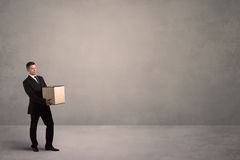 Businessman with empty box Royalty Free Stock Image