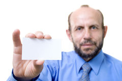 Businessman with an empty card. Showing the empty card, focused on hand with card Stock Photos