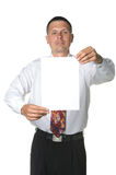 The businessman with the empty form of a paper Stock Images