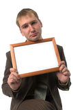 Businessman with empty frame Stock Images