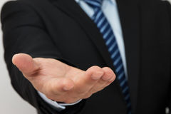 Businessman with empty hand. Close up of businessman with empty hand royalty free stock images