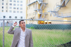 Businessman by an empty land lot Stock Photos