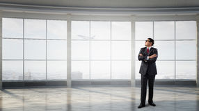 Businessman in empty office . Mixed media Royalty Free Stock Photography