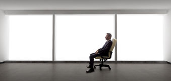 Businessman in an Empty Office Royalty Free Stock Images