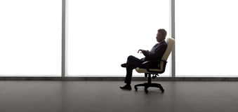 Businessman in an Empty Office Stock Photos