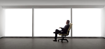 Businessman in an Empty Office Royalty Free Stock Photography