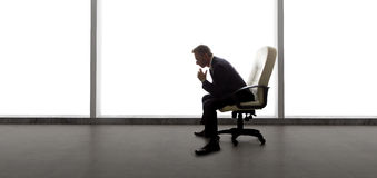 Businessman in an Empty Office Stock Images