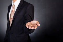 Businessman empty open cupped hands. Concept of giving or holdin Stock Photo