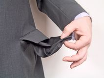Businessman with empty pocket. Close-up, businessman with empty pocket Stock Image