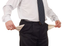 Businessman with empty pockets. Isolated on white stock image