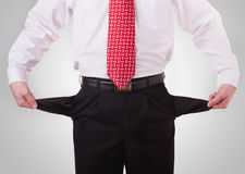 Businessman with empty pockets Royalty Free Stock Images