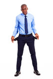 Businessman empty pockets. Broke african american businessman with empty pockets isolated on white Stock Photo