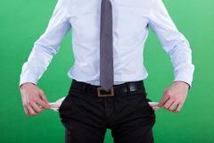 Businessman with empty pockets Royalty Free Stock Image