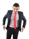 Businessman with empty pockets Stock Photography