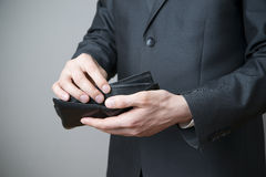 Businessman with empty purse in hands Royalty Free Stock Images
