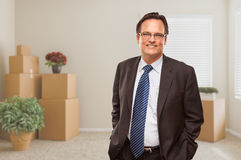 Businessman in Empty Room with Packed Boxes and Plants Royalty Free Stock Photography