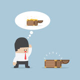 Businessman and empty treasure box Stock Images