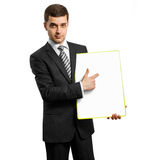 Businessman with empty write board. Businessman holding empty write board in his hands Royalty Free Stock Photo