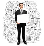 Businessman with empty write board. Businessman holding empty write board in his hands Stock Images