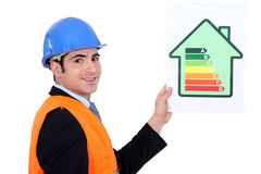 Businessman with energy consumption label. Businessman holding an energy consumption label stock photo
