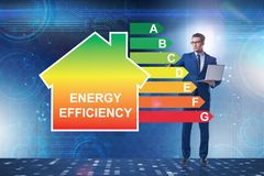 The businessman in energy efficiency concept. Businessman in energy efficiency concept stock photo