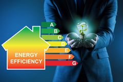 The businessman in energy efficiency concept. Businessman in energy efficiency concept stock images