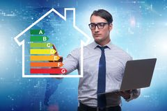 The businessman in energy efficiency concept. Businessman in energy efficiency concept royalty free stock photography