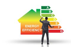 The businessman in energy efficiency concept. Businessman in energy efficiency concept stock image