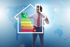The businessman in energy efficiency concept. Businessman in energy efficiency concept stock photos