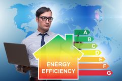 The businessman in energy efficiency concept stock image